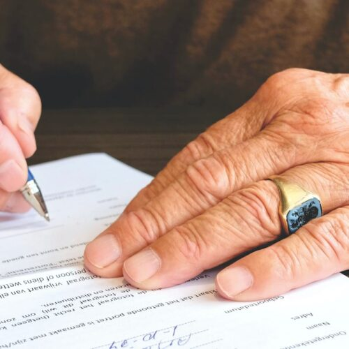 man signing small business loan